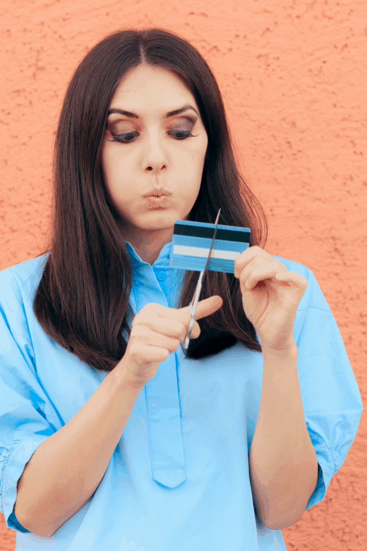woman cutting up credit cards