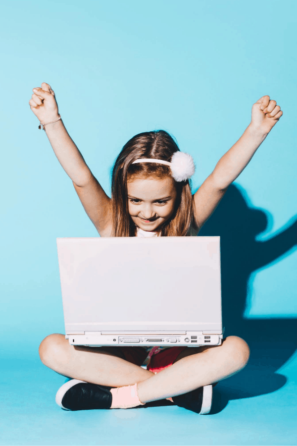 girl homeschooling on a laptop