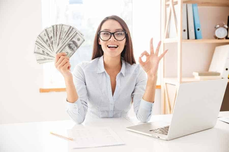 woman holding $10000