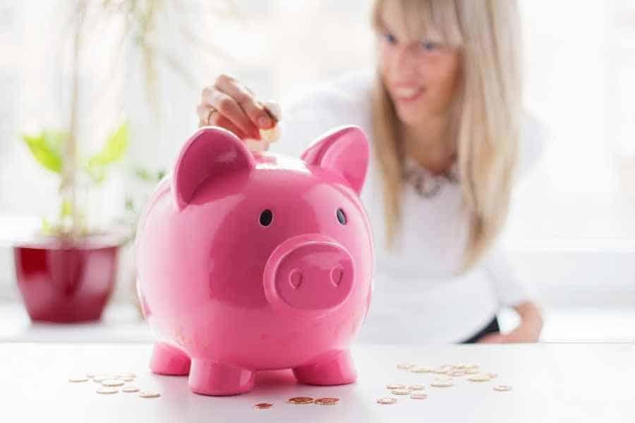 woman saving pennies