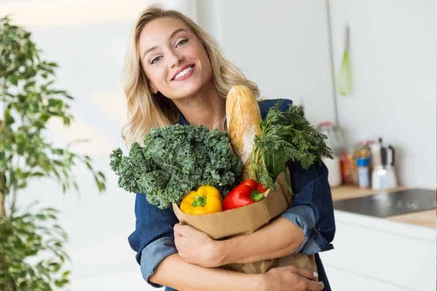woman holding cheap groceries