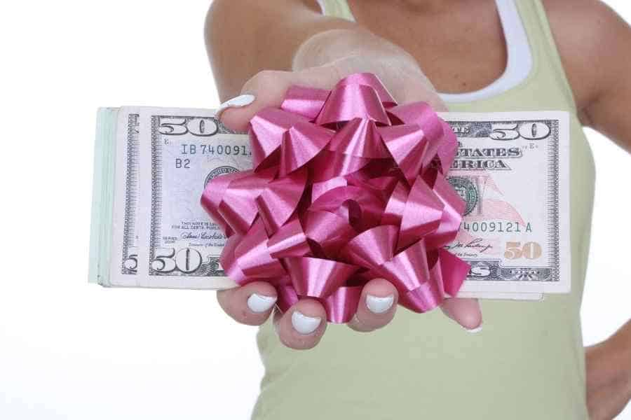 woman holding cash gift