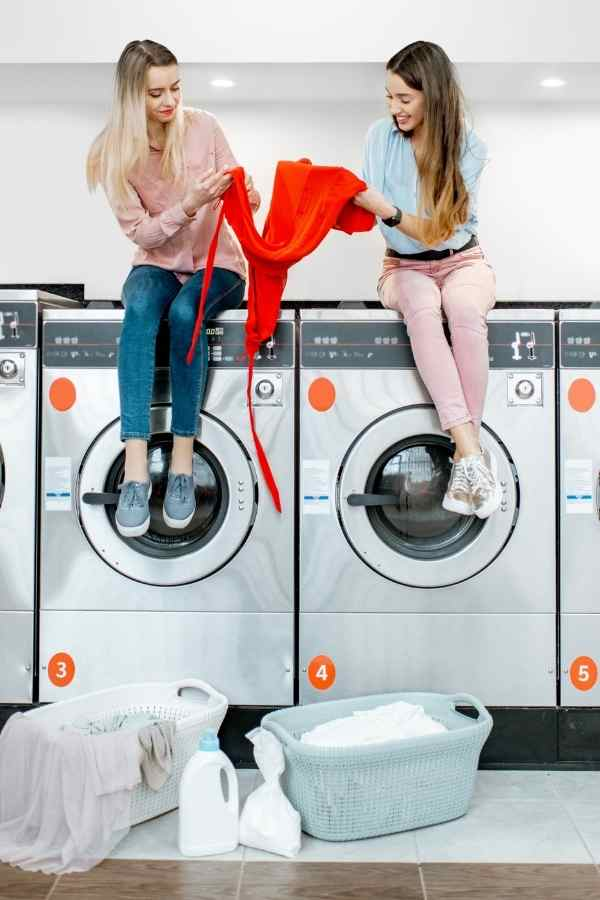 women doing laundry at a local laundromat